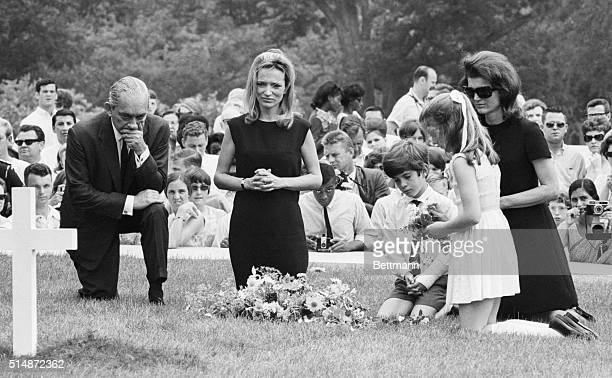 Lee Radziwell Jackie Kennedy and her children kneel at the grave of Robert F Kennedy The Senator was assassinated while running for president in 1968