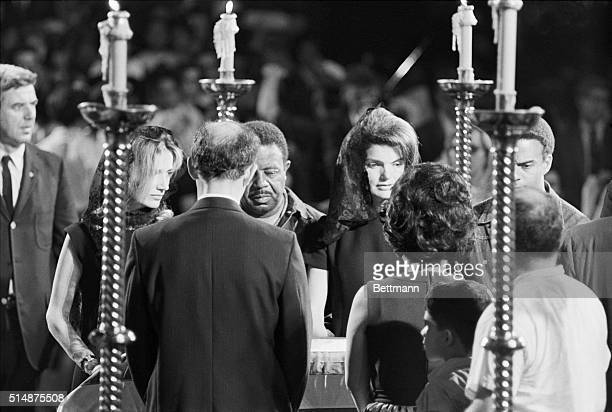 Lee Radziwell Jackie Kennedy and the Reverend Ralph Abernathy stand next to the coffin of Robert F Kennedy at St Patrick's Cathedral Kennedy was...