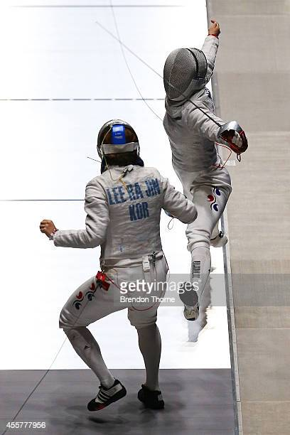 Lee Rajin and Kim Jiyeon of South Korea compete in the Women's Sabre Final during day one of the 2014 Asian Games at Goyang Gymnasium on September 20...