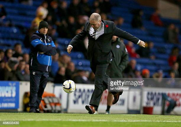 Lee Rangers manager Ally McCoist kicks a ball during the Scottish League Cup Quarter final between Rangers and St Johnstoneat Ibrox Stadium on...