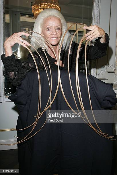 Lee Redmond from Utah quality for an entry in the 2007 edition of Guinness World Records Lee has grown her fingernails to a combined length of 751m