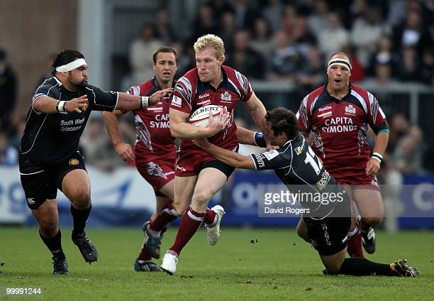 Lee Robinson of Bristol moves past Phil Dollman and Hoani Tui during the Championship playoff final match 1st leg between Exeter Chiefs and Bristol...