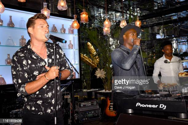 Lee Ryan and Simon Webbe of Blue perform during The Paul Strank Charity Summer Party at Opium on July 11 2019 in London England