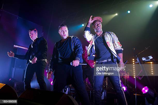 Lee Ryan Anthony Costa and Simon Webbe of Blue perform on stage at The Institute on October 21 2013 in Birmingham England