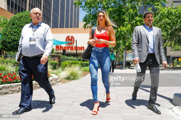 Lee Samuels Mikaela Mayer and George Ruiz head to the fight week press conference at Chesapeake Energy Arena on June 28 2018 in Oklahoma City...