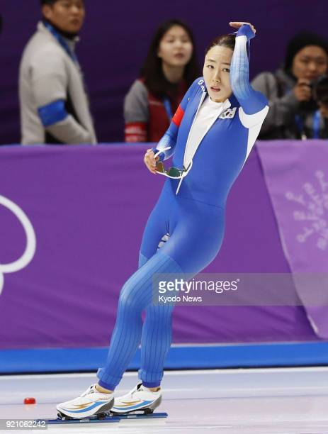 Lee Sang Hwa of South Korea checks her time after competing in the women's 500meter speed skating at the Pyeongchang Winter Olympics in Gangneung...
