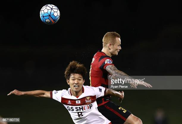 Lee Sangho of FC Seoul competes for the ball against Jack Clisby of the Wanderers during the AFC Champions League match between the Western Sydney...