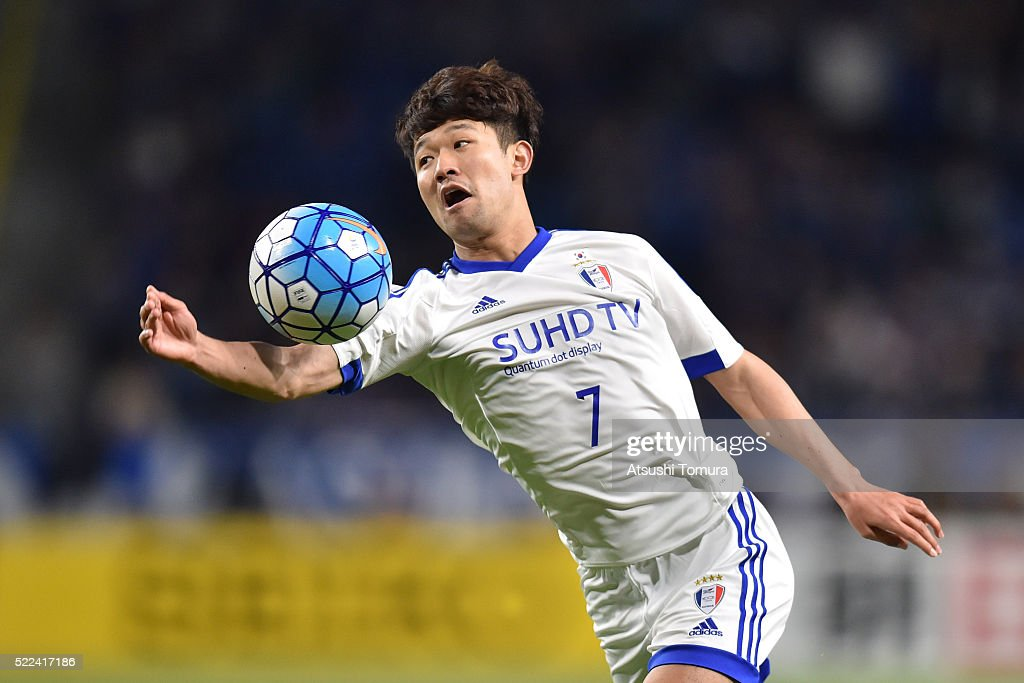 Lee Sang-Ho of Suwon Samsung Bluewings FC plays with his hand during the AFC Champions League Group G match between Gamba Osaka and Suwon Samsung Blue Wings at the Suita City Football Stadium on April 19, 2016 in Suita, Japan.