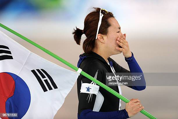 Lee SangHwa of South Korea reacts after winning the gold during the women's speed skating 500 m on day five of the Vancouver 2010 Winter Olympics at...