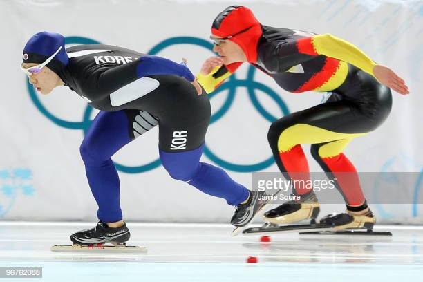Lee SangHwa of South Korea skates ahead of Jenny Wolf of Germany during the women's speed skating 500 m final on day five of the Vancouver 2010...