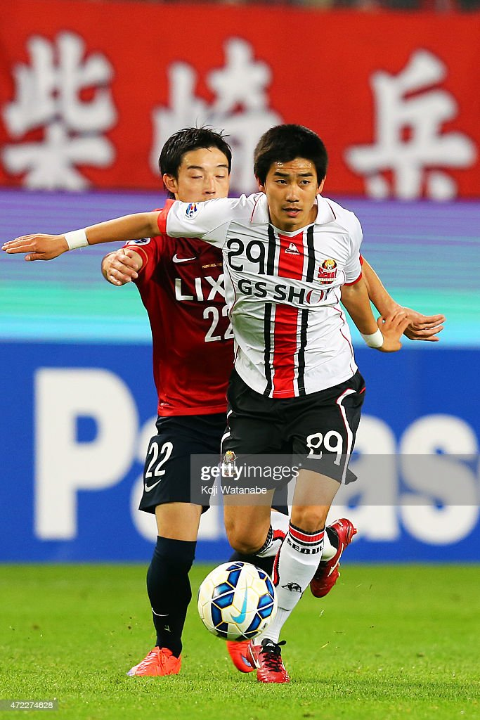 Lee Sanghyeob #29 of FC Seoul and Gen Shoji #3 of Kashima Antlers in action during the AFC Champions League Group H match between Kashima Antlers and FC Seoul at Kashima Stadium on May 5, 2015 in Kashima, Japan.