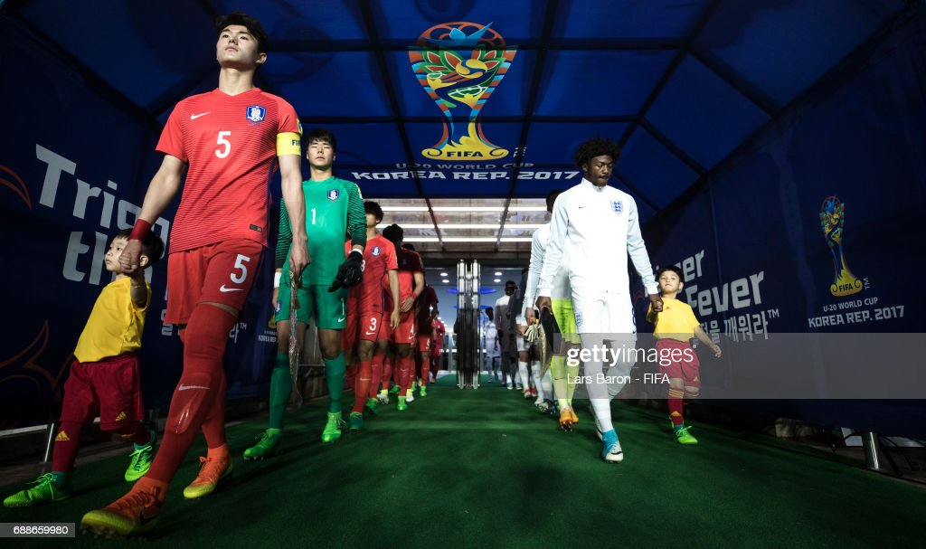 Lee Sangmin of Korea Republic and Ainsley Maitland-Niles of England lead their teams to the pitch during the FIFA U-20 World Cup Korea Republic 2017 group A match between England and Korea Republic at Suwon World Cup Stadium on May 26, 2017 in Suwon, South Korea.