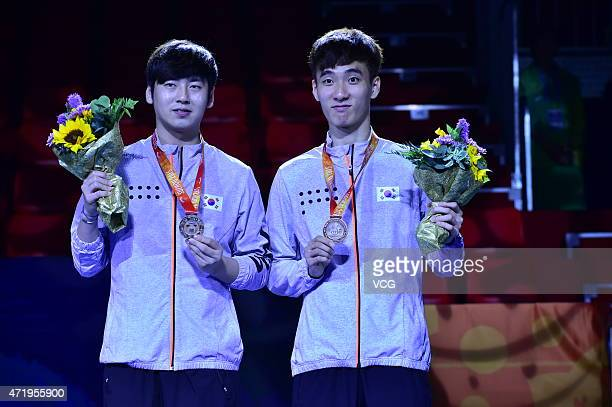 Lee Sang-Su and Seo Hyun-deok of South Korea stand on the podium after men's mixed doubles final match on day seven of the 2015 World Table Tennis...