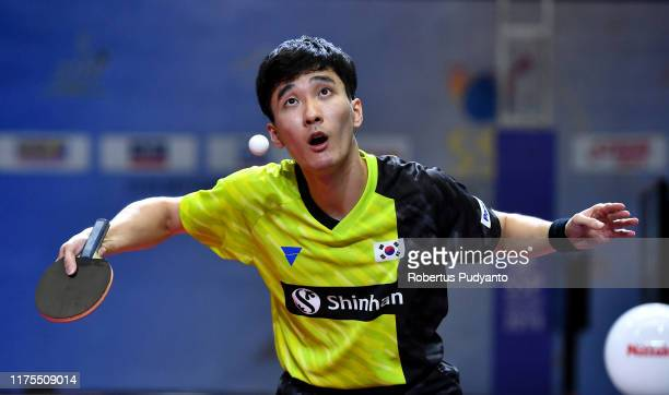 Lee Sangsu of Korea competes against Liang Jingkun of China during Men's Team Champions Division final match on day four of the ITTF-Asian Table...