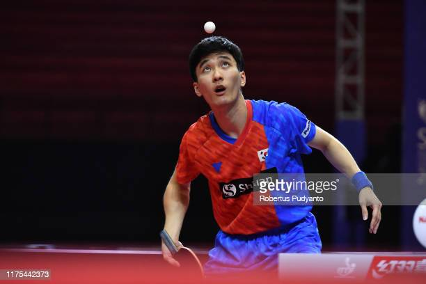 Lee Sangsu of Korea competes against Wang Tai-Wei of Chinese Taipei during Men's Team semi-final match on day four of the ITTF-Asian Table Tennis...