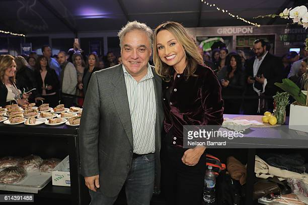 Lee Schrager, New York City Wine & Food Festival Founder and Director and Giada De Laurentiis pose at Barilla's Italian Table hosted by Giada De...