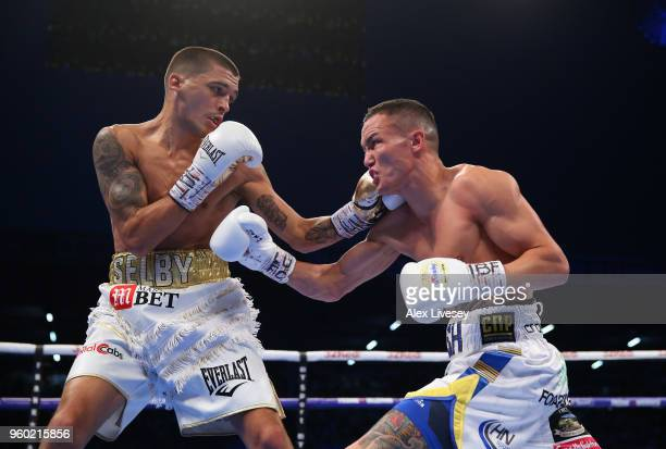 Lee Selby and Josh Warrington trade punches during IBF Featherweight Championship fight at Elland Road on May 19 2018 in Leeds England