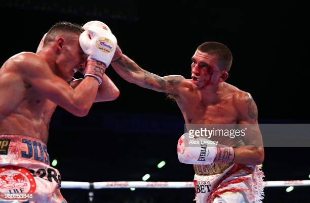 Lee Selby throws a right shot at Josh Warrington during IBF Featherweight Championship fight at Elland Road on May 19 2018 in Leeds England