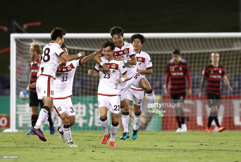 Lee Seok-Hyun of FC Seoul celebrates after scoring his teams first goal during the AFC Champions League match between the Western Sydney Wanderers and FC Seoul at Campbelltown Sports Stadium on April 11, 2017 in Sydney, Australia.