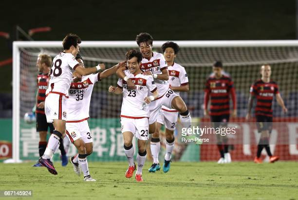 Lee SeokHyun of FC Seoul celebrates after scoring his teams first goal during the AFC Champions League match between the Western Sydney Wanderers and...