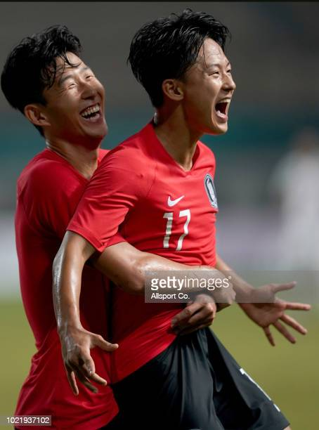Lee Seoungwoo celebrates with Son Heung Min of South Korea after scoring his second goal against Iran during the Men's football competition of the...