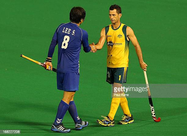 Lee Seung Il of Korea and Jamie Dwyer of Australia shake hands after the International Test match between the Australian Kookaburras and Korea at...