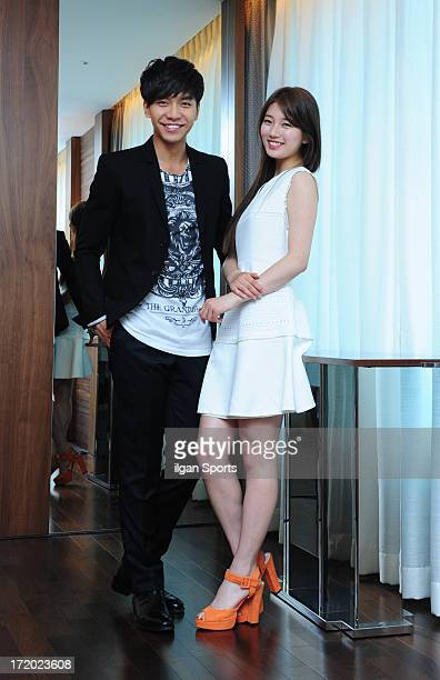 Lee SeungGi and SuZy pose for photographs on June 25 2013 in Seoul South Korea