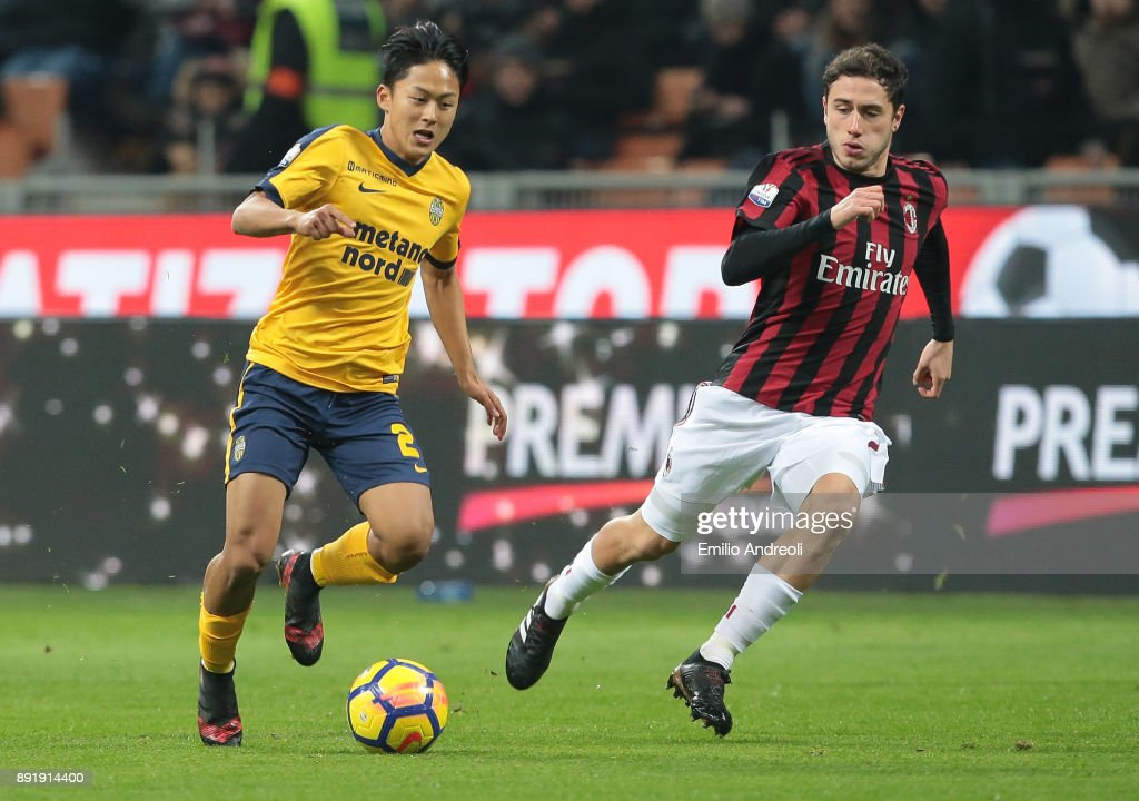 Lee Seung-Woo of Hellas Verona (L) is challenged by Davide Calabria of AC Milan during the Tim Cup match between AC Milan and Hellas Verona FC at Stadio Giuseppe Meazza on December 13, 2017 in Milan, Italy.