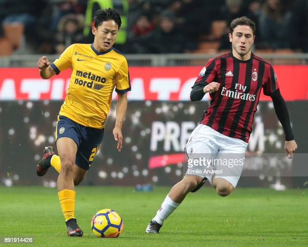 Lee SeungWoo of Hellas Verona is challenged by Davide Calabria of AC Milan during the Tim Cup match between AC Milan and Hellas Verona FC at Stadio...