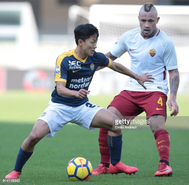Lee SeungWoo of Hellas Verona is challenged by Radja Nainggolan of AS Roma during the serie A match between Hellas Verona FC and AS Roma at Stadio...