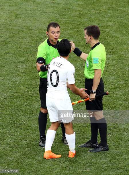 Lee SeungWoo of Korea Republic appeals to Referee Joel Aguilar and fourth official during the 2018 FIFA World Cup Russia group F match between Sweden...