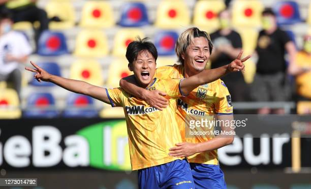 Lee Seung-Woo of STVV celebrates with Yuma Suzuki of STVV after scoring a goal during the Jupiler Pro League match between Sint-Truidense VV and...