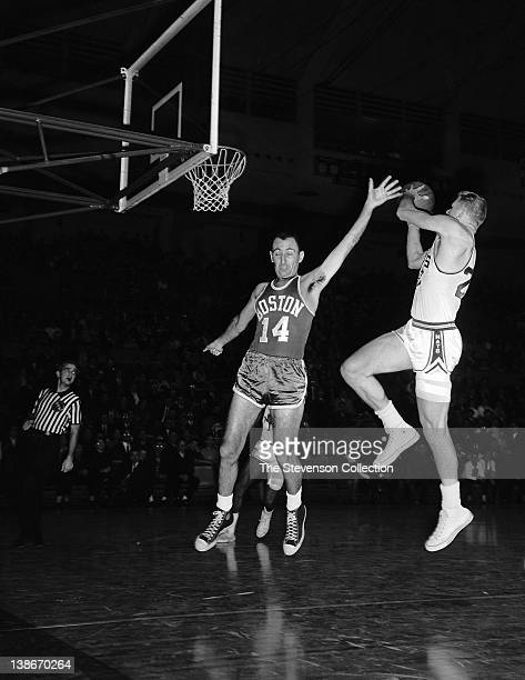 Lee Shaffer of the Syracuse Nationals shoots against Bob Cousy of the Boston Celtics on January 20 1963 at the Onondaga War Memorial Arena in...