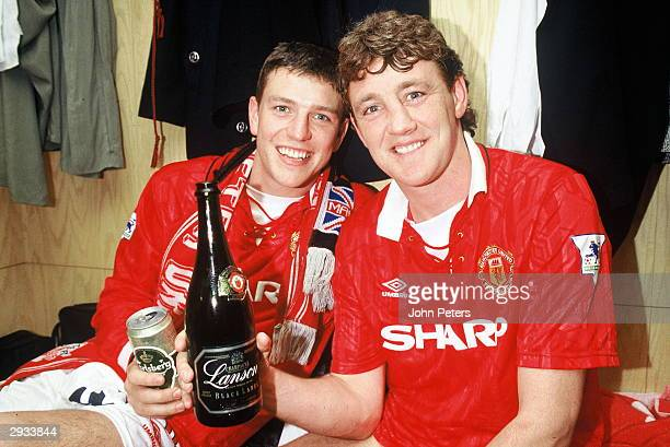 Lee Sharpe and Steve Bruce celebrate winning the Premiership Title in the dressing room after the FA Carling Premiership Match between Manchester...