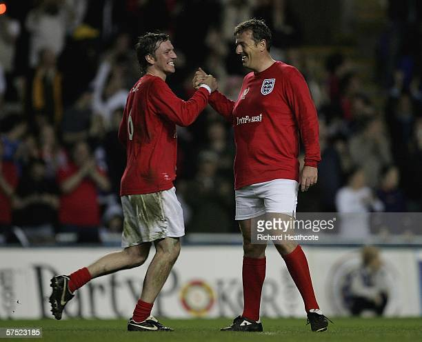 Lee Sharpe celebrates scoring the 2nd goal for England during the Legends match between England and Germany at The Madejski Stadium on May 3 2006 in...