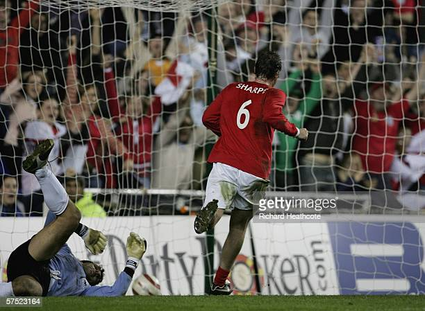 Lee Sharpe scores the 2nd goal for England during the Legends match between England and Germany at The Madejski Stadium on May 3 2006 in Reading...