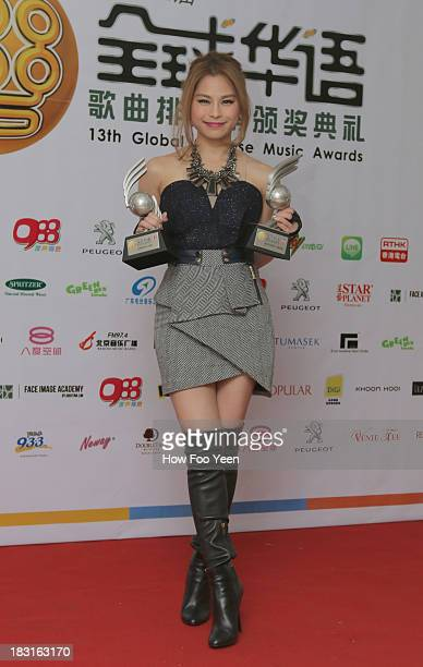 Lee Sing Li of Malaysia poses with her Awards at back stage during the 13th Global Chinese Music Awards at Putra Stadium on October 5 2013 in Kuala...