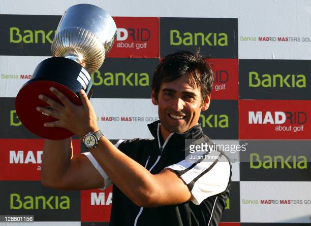 Lee Slattery of England celebrates with the trophy during round four of the Madrid Masters Golf at El Encin Golf Hotel on October 9 2011 in Madrid...