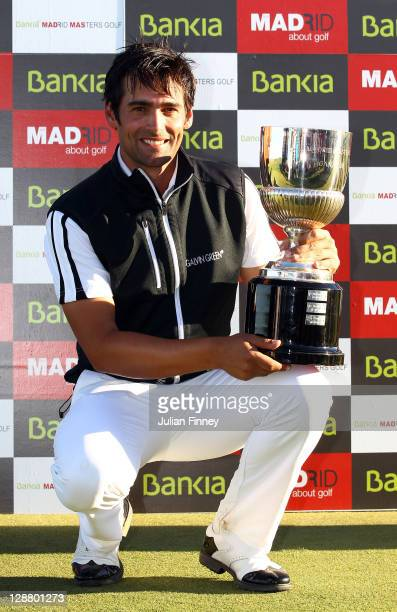 Lee Slattery of England celebrates with the winners trophy during round four of the Madrid Masters Golf at El Encin Golf Hotel on October 9 2011 in...