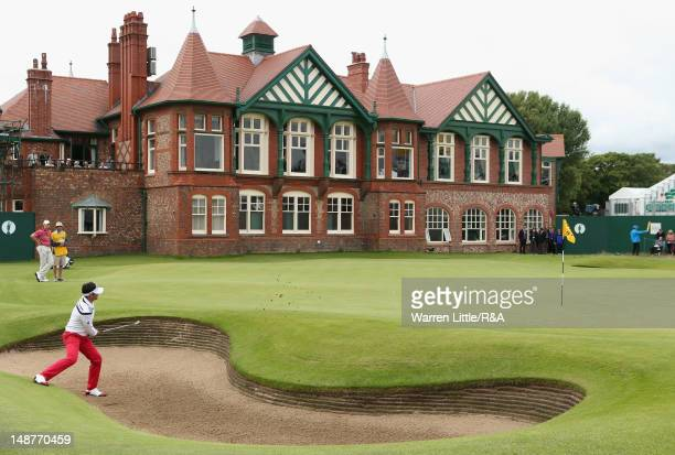 Lee Slattery of England hits from a greenside bunker on the 18th hole during the first round of the 141st Open Championship at Royal Lytham St Annes...