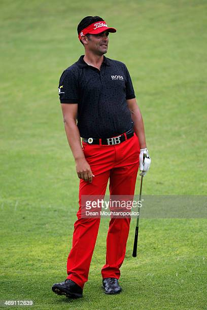 Lee Slattery of England looks on after he hits his second shot on the 9th hole during Day 1 of the Africa Open at East London Golf Club on February...
