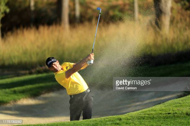 Lee Slattery of England plays his second shot from a bunker on the 9th hole during Day One of the BMW PGA Championship at Wentworth Golf Club on...