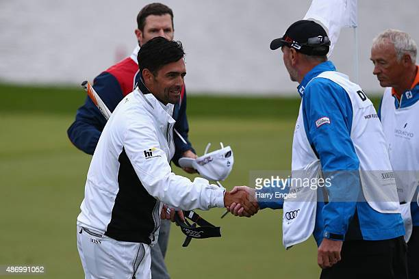 Lee Slattery of England shakes hands with the caddies after finishing his round on the eighteenth hole on day three of the M2M Russian Open at...