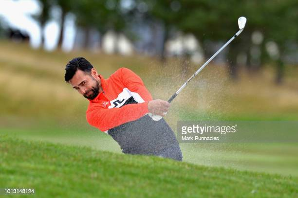 Lee Slattery of Great Britain plays from the bunker on hole fifteen during match 1 of Group A during day one of the European Golf Team Championships...
