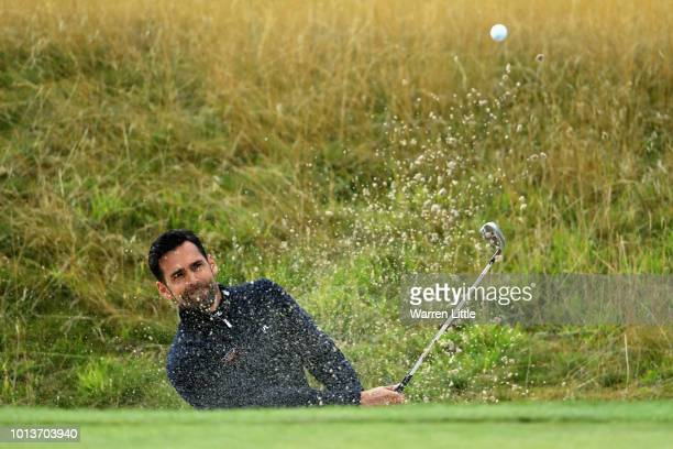 Lee Slattery of Great Britain plays out of a bunker on hole three during match 3 of Group A during day two of the European Golf Team Championships at...