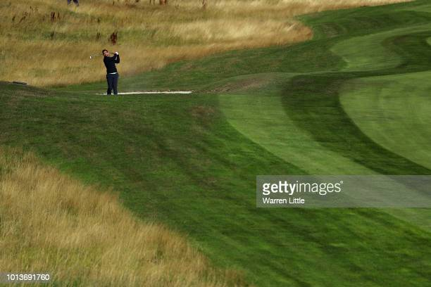 Lee Slattery of Great Britain takes his second shot on hole one during match 3 of Group A during day two of the European Golf Team Championships at...