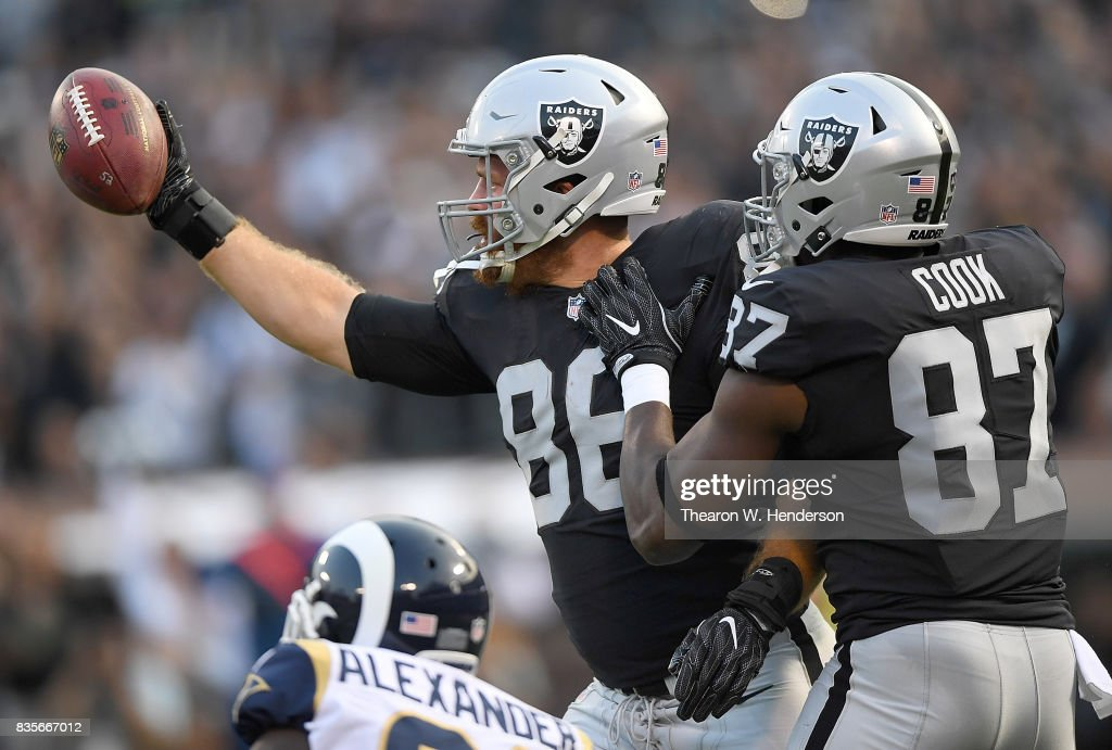 Lee Smith #86 and Jared Cook #87 of the Oakland Raiders celebrates after Smith caught a touchdown pass against the Los Angeles Rams in the first quarter of their preseason NFL football game at Oakland-Alameda County Coliseum on August 19, 2017 in Oakland, California.