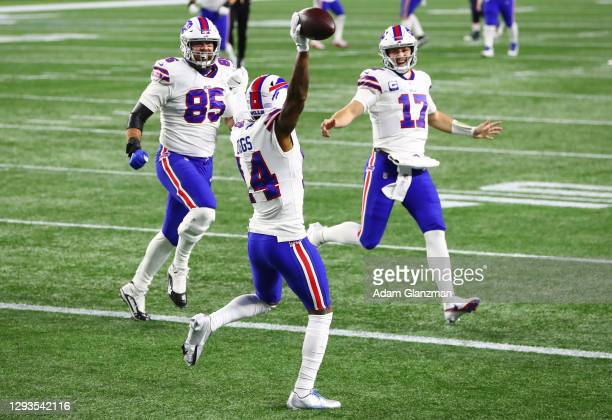 Lee Smith and Josh Allen celebrate with Stefon Diggs of the Buffalo Bills after Diggs' touchdown during the first half against the New England...