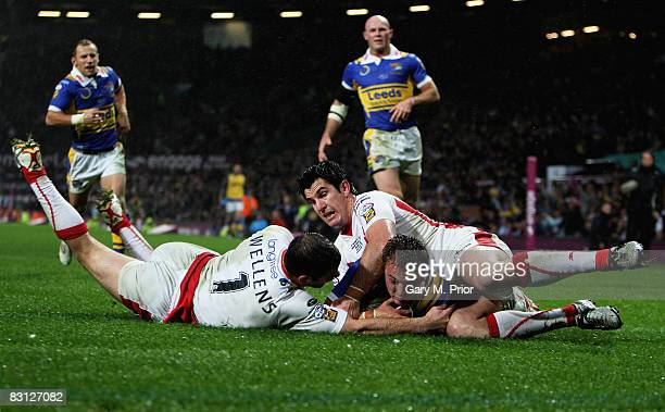 Lee Smith of Leeds slides over to score a try despite the tackled from Paul Wellens and Chris Flannery of StHelens during the engage Super League...