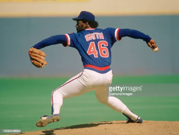 Lee Smith of the Chicago Cubs pitching during a game from his 1984 season with the Chicago Cubs Lee Smith played for 18 years with 8 different teams...